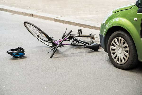 bike on ground in front of car