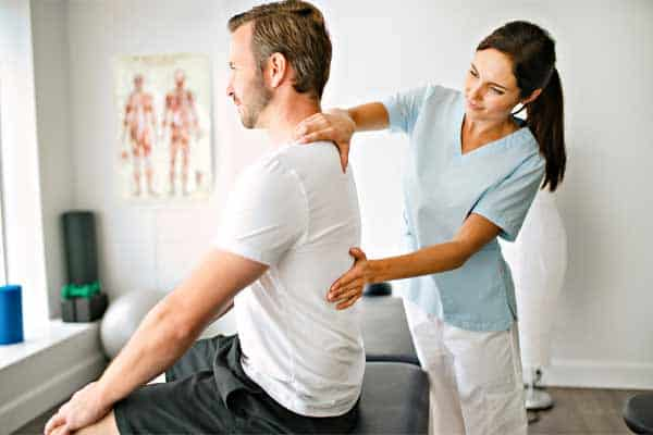 a man getting a back injury treated by a chiropractor