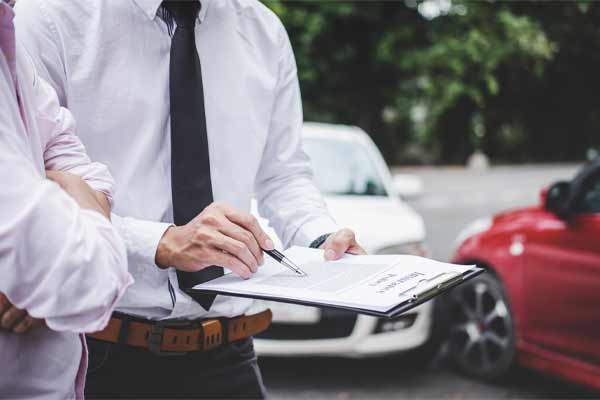 An insurance adjuster reviewing a car accident claim.