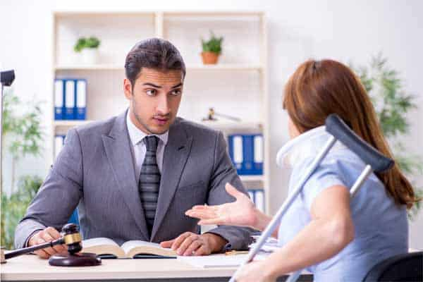 An injured woman meeting with a negligence accident lawyer in Decatur.
